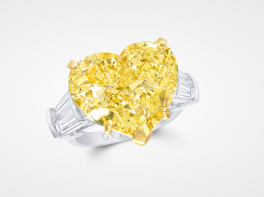 Incredible 18.47 Carat Heart Shaped Fancy Intense Yellow Diamond Ring.