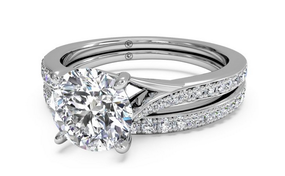 RITANI DOUBLE FRENCH-SET DIAMOND 'V' ENGAGEMENT RING WITH SURPRISE DIAMONDS