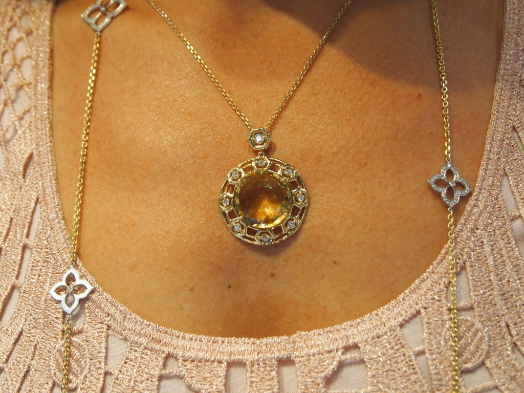 Gumuchian Bee Pendant set in 18k Yellow gold with a whopper 24.5 carat citrine. The faceting makes it look like honeycomb.