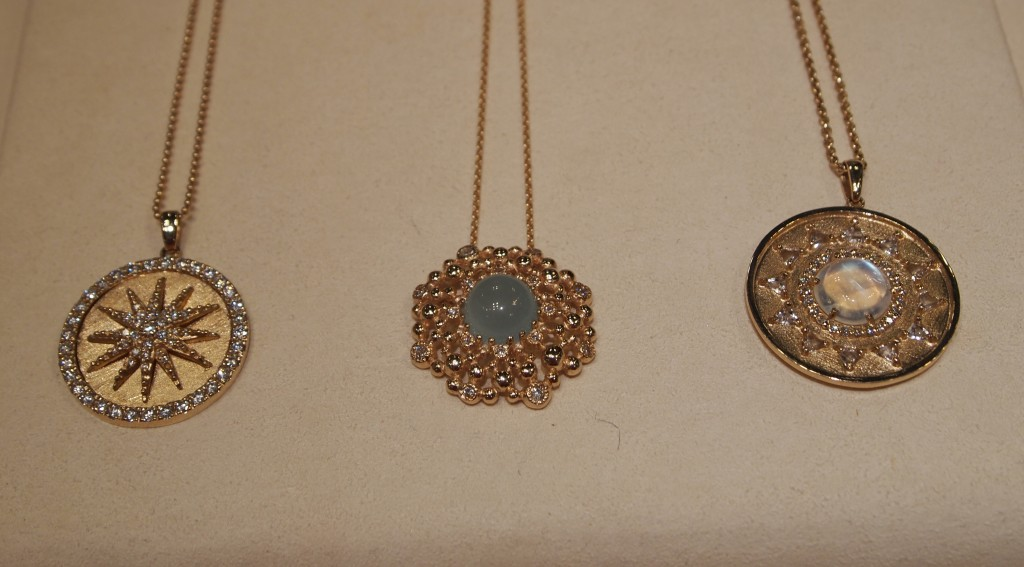 Pendants from Anzie featuring diamonds, and moonstone in yellow gold.