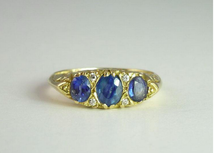 Oval Sapphires and Round Brilliant Diamonds Captivate in this French 18k Gold Band. $795 from Ruby Lane Seller Crystal River Gallery.