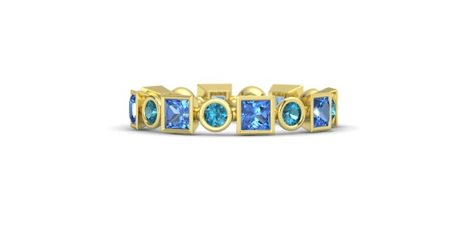 Alternating  Princess and Round Brilliant cut Blue Topaz and London Blue Topaz are a Fresh Modern Take on the Eternity Band.