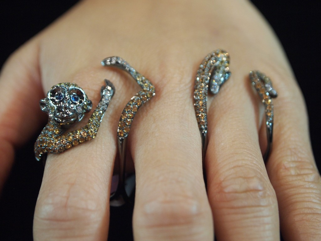 Love the Impish expression on this little guys face. Champagne diamond monkey ring by Wendy Yue