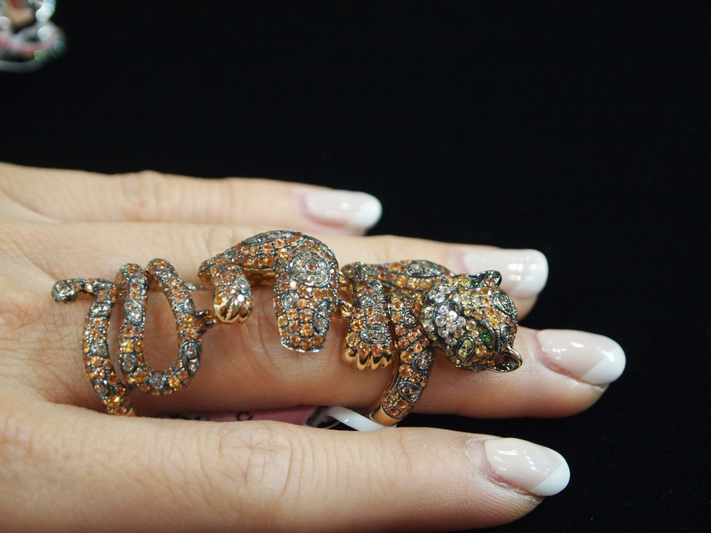 Full Finger Panther Ring from wendy Yue, Featuring diamonds, garnets and emerald eyes. Meow.