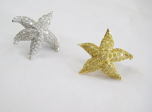 Pair of Starfish Brooches in Yellow and White Gold, set with white and yellow diamonds.
