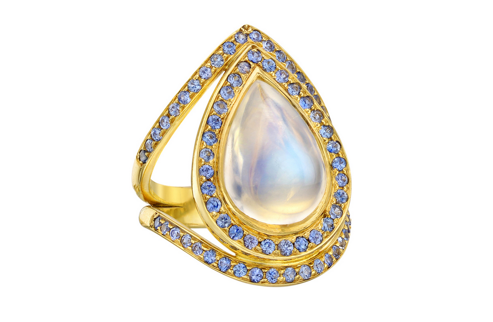 Pear Shaped Moonstone and Sapphire Accented Yellow Gold Ring from Temple St. Clair. Available from Betteridge