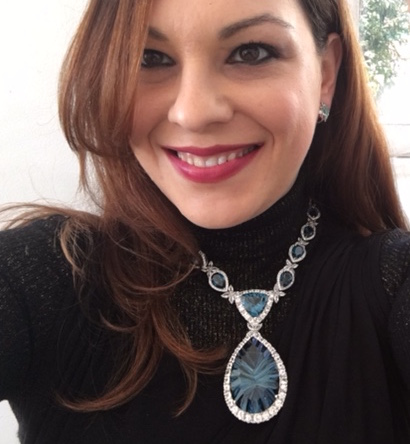 Blue Topaz and white sapphire necklace by Richard Berberian for Elyse Fine Jewelers.