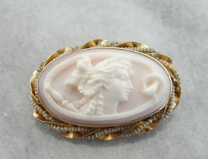 Goddess and Snake Seed Pearl Cameo Pin. from MS Jewelers