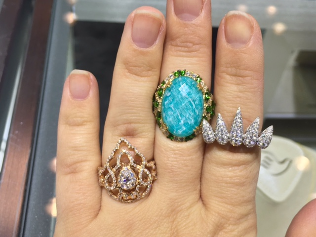 A trio of rings featuring diamonds and colored gems from Doves Jewelry