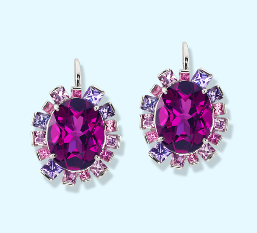 Grape Garnets surround by pastel pink and purple gems set in white gold. By Jane Taylor Jewelry